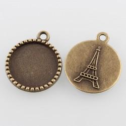 Support de cabochon rond et plat avec tour Eiffel à l'arrière en décor. Couleur bronze antique