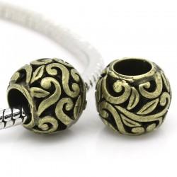 Perle ronde sculptée de type Pandora volutes et fleurs couleur bronze antique